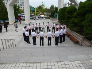 012 men praying outside Yoido FGC