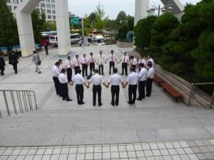 012 men praying outside Yoido FGC